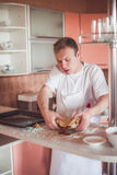 Man cooking at kitchen Stock Photography