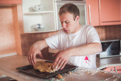 Man cooking at kitchen Royalty Free Stock Photography