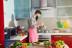 Man cooking at kitchen making healthy vegetable Stock Photo