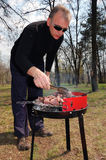 Man cooking meat Stock Photography