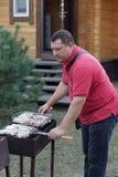 Man cooking meat Stock Photos