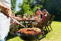 Man cooking meat on barbecue grill at summer party Stock Images