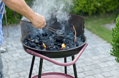 Man cooking meat on a barbecue Royalty Free Stock Image