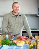 Man cooking meat. Man  cooking meat in home kitchen Stock Photos