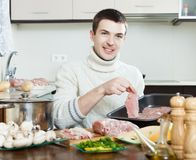 Man cooking  meat Royalty Free Stock Photos