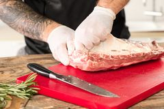 Man cooking meat steak on kitchen. Or home Royalty Free Stock Photos
