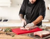 Man cooking meat steak on kitchen. Or home Stock Photo