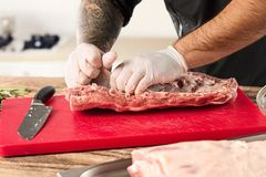 Man cooking meat steak on kitchen. Or home Stock Photography