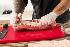 Man cooking meat steak on kitchen. Or home Stock Photos