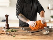 Man cooking meat steak on kitchen. Or home Royalty Free Stock Photo