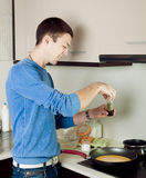 Man cooking omelet Royalty Free Stock Image