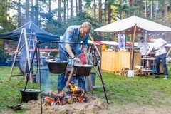 Man cooking on open fire royalty free stock photography