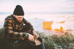 Man cooking outdoor pancakes breakfast travel lifestyle vacations stock photography