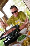 Man cooking outdoors stock photos