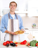 Man Cooking Pizza stock photo