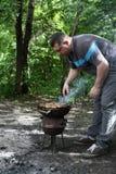 Man cooking pork Stock Photo