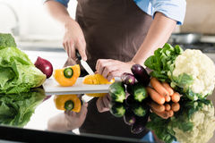 Man cooking and preparing salad in kitchen Stock Photo