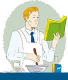 Man cooking with recipe book Royalty Free Stock Photo