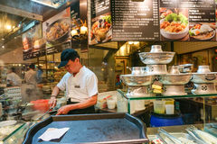 A man cooking at the restaurant in Singapore Royalty Free Stock Image