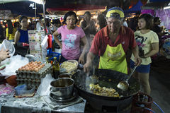 Man cooking rice cake at PJ Pasar Malam Stock Photography