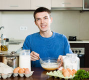 Man cooking scrambled eggs Stock Image