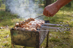 Man cooking shashlick outdoors Royalty Free Stock Photography