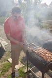 Man cooking shashlyk Royalty Free Stock Images