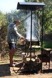 Man cooking shish kebab stock photo