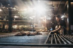 Man cooking at a stand in Mercato Metropolitano market in London, UK stock photos