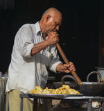 A man cooking street foods at local market in Gaya, India.  Royalty Free Stock Photo