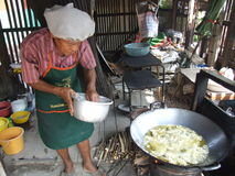Man cooking Thai food, Thailand. Stock Image