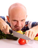 Man cooking with tomato, cucumber, pepper Stock Photos
