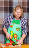 Man cooking with tomatoes and cucumbers Royalty Free Stock Photo