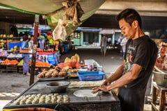 Man cooking traditional burmese street food in Yangon, Myanmar Stock Images