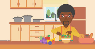 Man cooking vegetable salad. Royalty Free Stock Photos