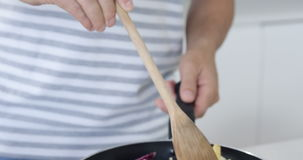Man cooking vegetables stock video footage