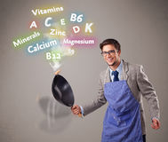 Man cooking vitamins and minerals Stock Photos