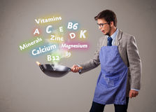 Man cooking vitamins and minerals Royalty Free Stock Photos
