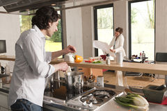 Man cooking woman with plan Royalty Free Stock Photography