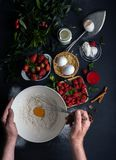 A man cooks the dessert stock photography