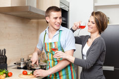 Man cooks dinner Stock Photos