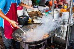 Man cooks food at Kimberly Street Food Night Market Stock Images