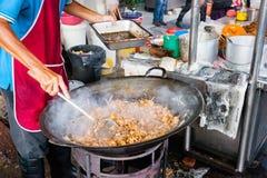 Man cooks food at Kimberly Street Food Night Market Stock Photo