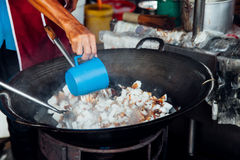 Man cooks at Kimberly Street Food Night Market. Man is cooking at Kimberly Street Food Night Market in George Town, Malaysia Stock Photos