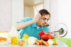 Man cooks lunch with vegetables Stock Photo