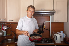 Man cooks meat Royalty Free Stock Photography