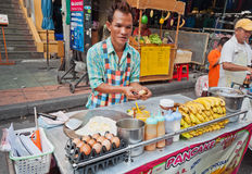 Man cooks Thai Banana Pancake on the street Stock Photo