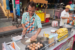 Man cooks Thai Banana Pancake on the street Stock Photos