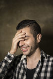 Man with cool plaid shirt laughing Stock Image