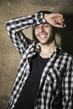 Man with cool plaid shirt posing laughing Stock Photo